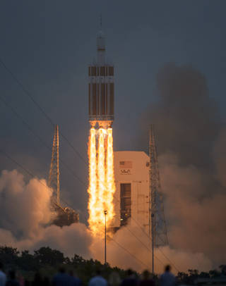 The United Launch Alliance Delta IV Heavy rocket with NASA's Orion spacecraft mounted atop, lifts off from Cape Canaveral Air Force Station's Space Launch Complex 37 at at 7:05 a.m. EST, Friday, Dec. 5, 2014, in Florida.