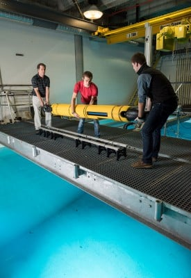 GTRI principal research engineer Mick West, graduate student Jacob Buffo of the School of Earth and Atmospheric Sciences, and undergraduate Matthew Meister of the School of Mechanical Engineering handle the 210-pound Icefin at Georgia Tech's Underwater Acoustics Research Laboratory.