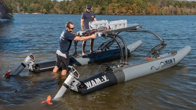 Graduate students Dmitry Bershadsky and Pierre Valdez of the School of Aerospace Engineering prepare a 16-foot wave adaptive modular vehicle (WAM-V) for testing at Georgia's Sweetwater Creek State Park.