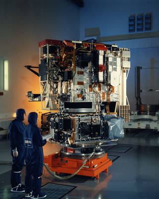 ESA engineers examined the Solar and Heliospheric Observatory during assembly at the Matra Marconi Space facility. Credits: SOHO (ESA & NASA)