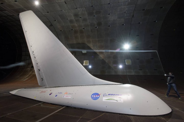 Researchers with NASA's Environmentally Responsible Aviation project coordinated wind-tunnel tests of an Active Flow Control system -- tiny jets installed on a full-size aircraft vertical tail that blow air -- to prove they would provide enough side force and stability that it might someday be possible to design smaller vertical tails that would reduce drag and save fuel. Credits: NASA/Dominic Hart