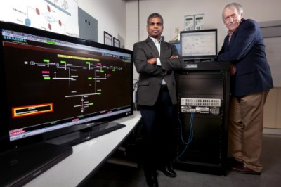 """Manimaran Govindarasu and Doug Jacobson, left to right, are leading studies of power grid cyber security, including development of the """"PowerCyber"""" testbed. Image credit: Christopher Gannon."""