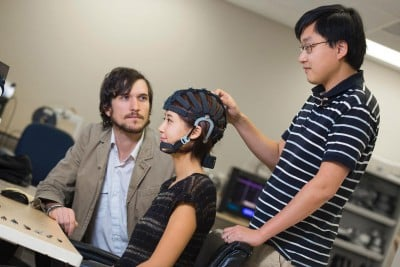 Tim Mullen, left, and Mike Yu Chi are the lead researchers on the study. Both are UC San Diego alumni. Mullen cofounded Qusp, a start up focused on analytics, and Chi cofounded Cognionics, which developed the EEG headset featured in the study. Image credit: UCSD