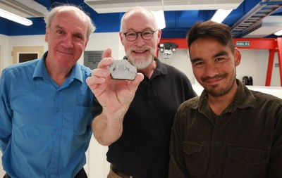 Paul Warren, Edward Young (holding a sample of a rock from the moon) and Issaku Kohl. Photo credit: Christelle Snow/UCLA