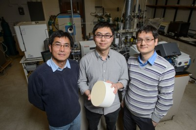 Industry mentor Wen Fu, left, Yanbing Guo, and Pu-Xian Gao in a lab at the Institute of Materials Science with a sample of the catalyst they have developed. Credit: Peter Morenus/UConn Photo