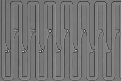 To track the family history for a single cell, researchers engineered a microfluidic device that traps first an individual cell and then all of its descendants. The device has several connected channels, each of which has a trapping pocket used to capture single cells in precise locations. After the initial cell grows and divides, its progeny float downstream and are captured in the next available trap. Through this process of dividing and trapping, researchers were able to track where single cells traveled after division and to determine lineage relationships for multiple generations. Image courtesy of the researchers