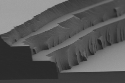 The layer-by-layer solar thermal fuel polymer film comprises three distinct layers (4 to 5 microns in thickness for each). Cross-linking after each layer enables building up films of tunable thickness. Image courtesy of the researchers
