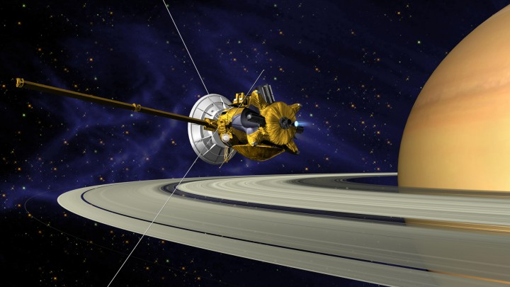 This is an artists concept of Cassini during the Saturn Orbit Insertion (SOI) maneuver, just after the main engine has begun firing. Image credit: NASA/JPL