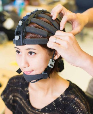 The headset features 64 channels for EEG monitoring. Image credit: UCSD