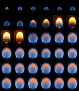 A composite image of candle flames from the Burning and Suppression of Solids (BASS) investigation on the International Space Station. Credits: NASA
