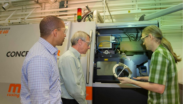 From left: Lawrence Livermore National Laboratory researchers — Ibo Matthews, a principal investigator leading the Lab's effort on the joint open source software project; Wayne King, director of the Accelerated Certification of Additively Manufactured Metals Initiative; and Gabe Guss, engineering associate — examine a 3D-printed part manufactured using the selective laser melting process.