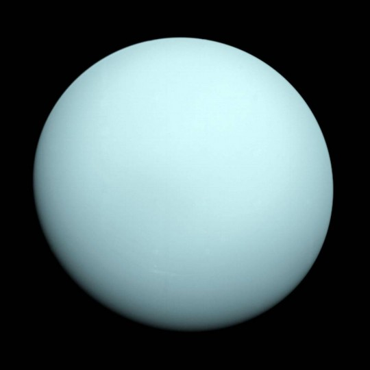 Arriving at Uranus in 1986, Voyager 2 observed a bluish orb with extremely subtle features. A haze layer hid most of the planet's cloud features from view. Credits: NASA/JPL-Caltech