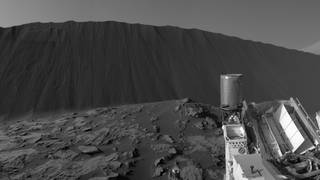 """NASA's Curiosity Mars rover, partway through the first up-close study ever conducted of extraterrestrial sand dunes, is providing dramatic views of a dune's steep face, where cascading sand has sculpted very different textures than the wavy ripples visible on the dune's windward slope. Panoramic scenes dominated by the steep face of a dune called """"Namib Dune"""" are online at these sites: https://www.jpl.nasa.gov/spaceimages/details.php?id=PIA20284 https://www.jpl.nasa.gov/spaceimages/details.php?id=PIA20281"""