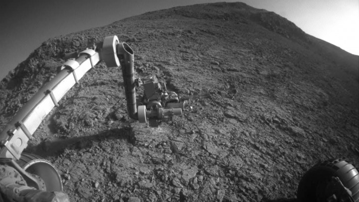 """The target beneath the tool turret at the end of the rover's robotic arm in this image from NASA's Mars Exploration Rover Opportunity is """"Private John Potts."""""""