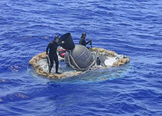 NASA's Low-Density Supersonic Decelerator (LDSD) hardware is recovered after its flight by members of the U.S. Navy's Mobile Diving Salvage Unit (MDSU) 1 Explosive Ordnance Detachment. Credits: U.S. Navy