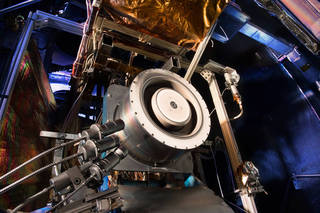 NASA's Asteroid Redirect Mission will assess a number of new capabilities, like advanced Solar Electric Propulsion (SEP). That advanced propulsion system will be needed for future astronaut expeditions into deep space, including to Mars. Shown here is a Hall thruster being evaluated at NASA's Glenn Research Center. Hall thrusters are part of an SEP system. It uses 10 times less propellant than equivalent chemical rockets. Hall thrusters trap electrons in a magnetic field and use them to ionize the onboard propellant. Credits: NASA/Michelle M. Murphy (Wyle Information Systems, LLC)