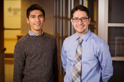 Inspired by the principles of a conventional sodium ion battery, Illinois mechanical science and engineering professor Kyle Smith, right, and graduate student Rylan Dmello found they could desalinate salt water more efficiently than using traditional methods. Photo by L. Brian Stauffer
