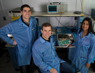 Jared Lucey, Jeffrey Piepmeier, and Priscilla Mohammed, a research engineer at Morgan State University, are developing a new CubeSat mission to test RFI-mitigation strategies. They are shown here with a testbed for testing mitigation algorithms. Credits: Bill Hrybyk/NASA