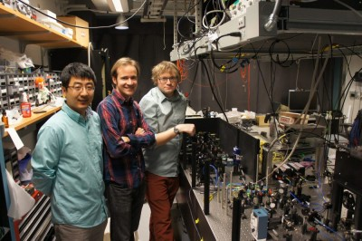 From left: Brian Zhou, Christopher Yale and F. Joseph Heremans, researchers at the University of Chicago's Institute for Molecular Engineering, and the optical apparatus they used to control geometric phases in diamond. Image credit: Awschalom Group