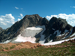 Rolling Thunder Mountain near Talus Lake is part of the Teton Range. The orange rock in the foreground is Webb Canyon gneiss, granite formed by decompression melting more than 2.6 billion years ago. Image credit: Carol Frost