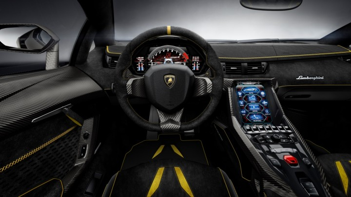 Interior now has special carbon fibre styling elements, first seen in Sesto Elemento, and a new touchscreen for the infotainment system. Image credit: media.lamborghini.com.