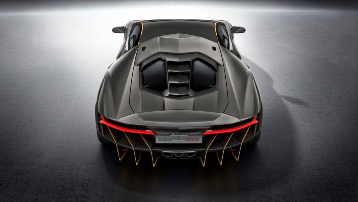 Spoiler and splitter are meant to keep Centenario car stable at high speeds, while open rear should vent the hot air out from the V12 engine. This car also has rear-wheel steering to make it more agile. Image credit: media.lamborghini.com.