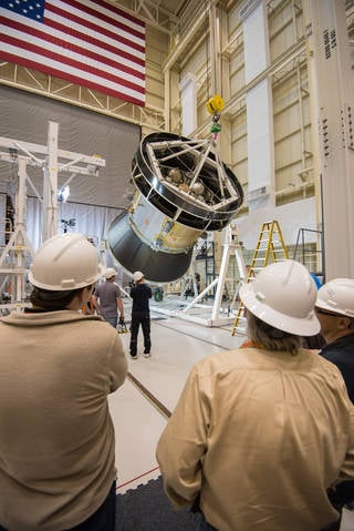 A representative structure of Orion's service module, which is being testing at Plum Brook Station, was tilted to a 90 degree angle in preparation for the solar array deployment test.