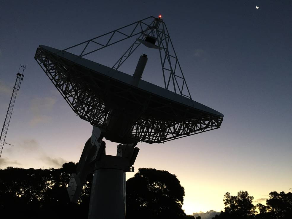 """The new 12-meter (39-foot) antenna at the Kōke'e Park Geophysical Observatory in Hawaii achieved """"first light"""" – its first time observing radio sources as a single dish – and its first interferometric fringes in early February 2016. Credits: MIT Haystack Observatory/Ganesh Rajagopalan"""