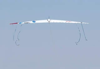 The streamers on the Prandtl-D No. 2 as it is launched illustrate how aerodynamic forces are maximized as birds overlap wingtips when flying in formation. Credits: NASA Photo / Tom Tschida