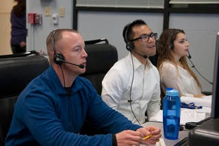 From left, Mike Frederick and NASA interns Jack Ly and Kassidy McLaughlin monitor a flight. Credits: NASA Photo / Lauren Hughes