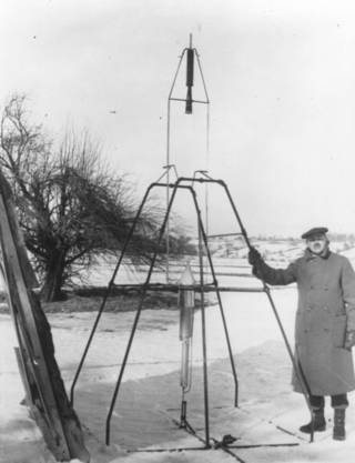 Robert Goddard stands next to his first liquid-fueled rocket prior to its launch on March 16, 1926. Credits: Clark University Robert H. Goddard Archive