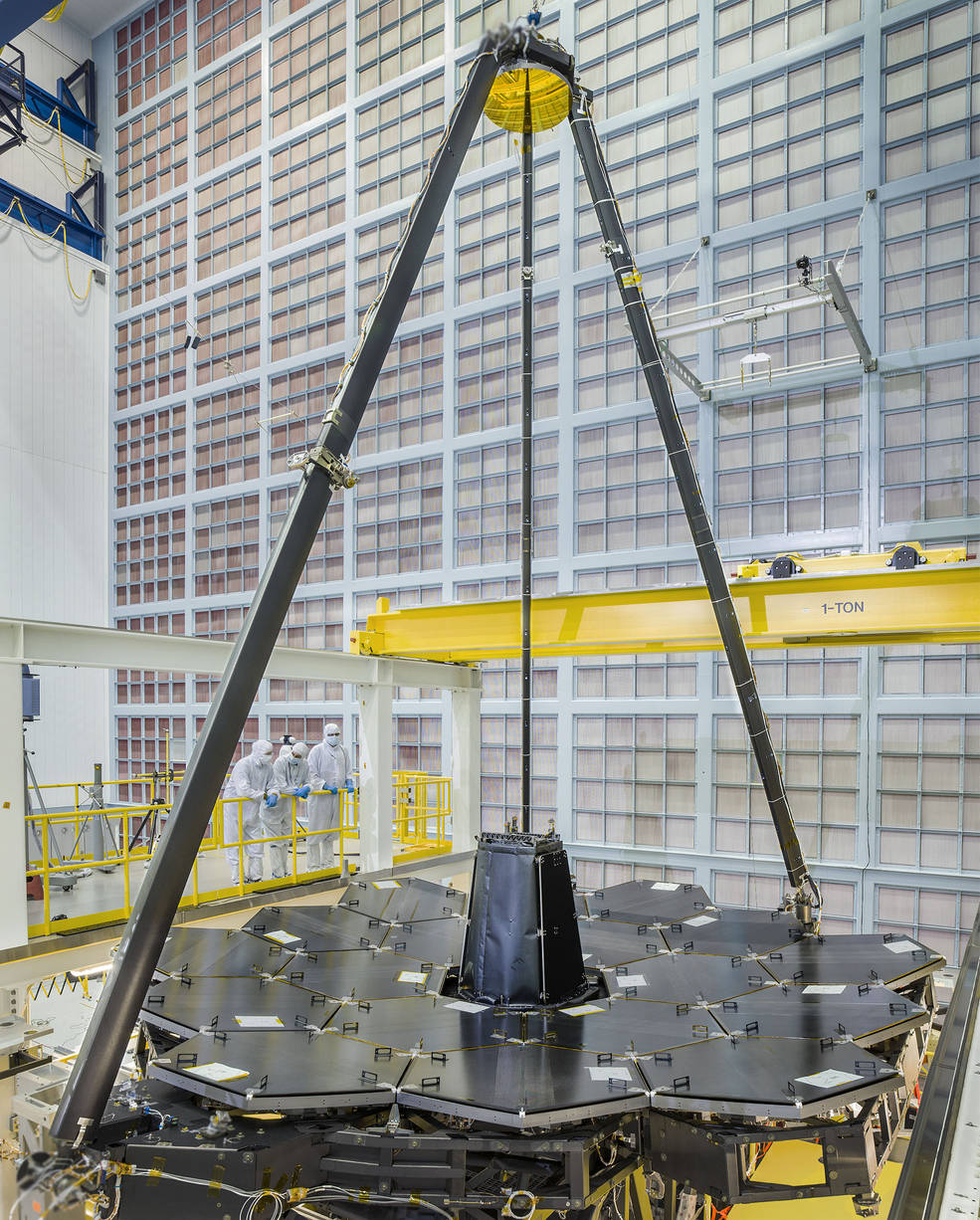 NASA's James Webb Space Telescope completed primary mirror sits in the cleanroom at NASA Goddard Space Flight Center, and supported over it on the tripod is the secondary mirror. Credits: NASA/Chris Gunn