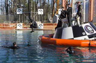 Astronaut Suni Williams jumps into the Hydro Impact Basin at NASA's Langley Research Center after completing a practice session with an Air Force pararescue team with a mock-up of a Boeing CST-100 Starliner. Credits: NASA/ Langley Research Center