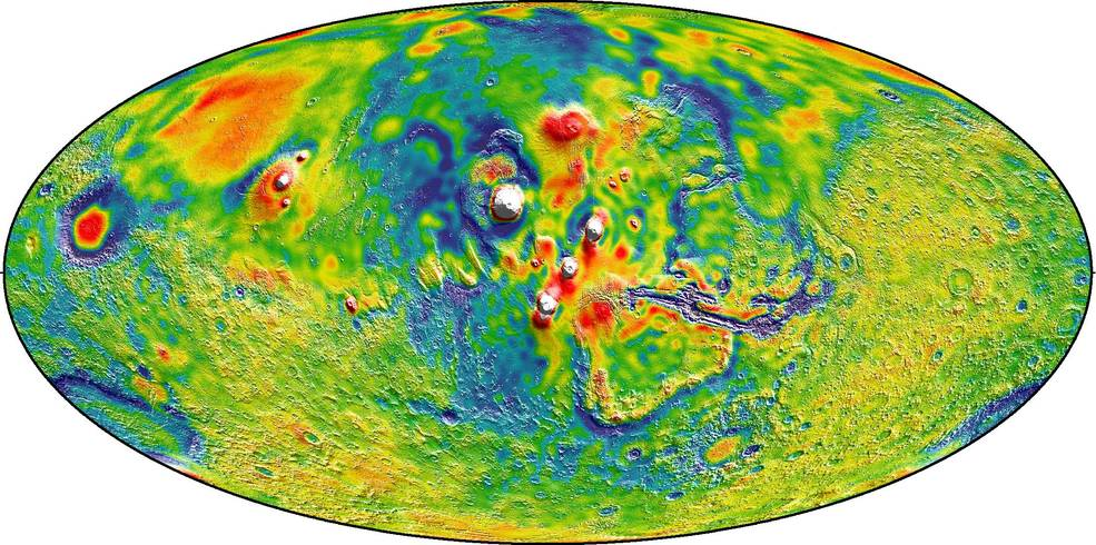 A Martian gravity map showing the Tharsis volcanoes and surrounding flexure. The white areas in the center are higher-gravity regions produced by the massive Tharsis volcanoes, and the surrounding blue areas are lower-gravity regions that may be cracks in the crust (lithosphere). Credits: MIT/UMBC-CRESST/GSFC