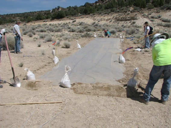 Deployment of a large tarp, which is used to capture gases with the LLNL Smart Sampler as they rise to the surface and collect underneath.