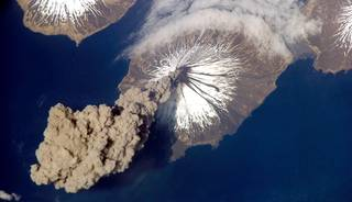 On May 23, 2006, Expedition 13 astronaut Jeff Williams contacted the Alaska Volcano Observatory to report that the Cleveland Volcano had produced a plume of ash. Shortly after the activity began, he took this photograph. Cleveland Volcano, situated on the western half of Chuginadak Island, is one of the most active of the volcanoes in the Aleutian Islands. Credits: NASA/Jeff Williams