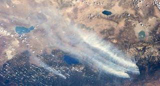 An Expedition 36 crew member recorded this view of the massive drought-aided fire in and around California's Yosemite National Park and the Stanislaus National Forest on Aug. 26, 2013. Some 3,700 firefighters battled the blaze which covered more than 224 square miles. Credits: NASA