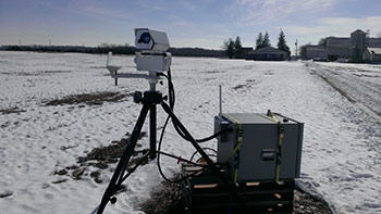 This laser scanner monitors a field near Ft. Wayne, Indiana, for carbon dioxide leaking from underground. The data, needed to measure carbon sequestration success, helped NIST improve monitoring efforts. Image credit: Harris Corporation