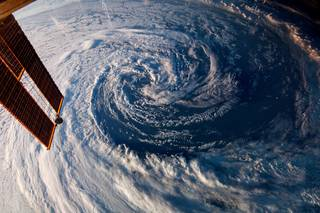 On March 29, 2014, Expedition 39 crew members used a digital still camera to photograph this pre-winter storm located just off the coast of southwestern Australia. A solar array panel on the orbital outpost is in the left side of the frame. Credits: NASA