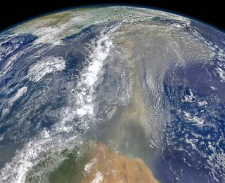 Satellites have documented that human-produced and natural air pollution can travel a long way. This 2014 NASA satellite image shows a long river of dust from western Africa (bottom of image) push across the Atlantic Ocean. Credits: NASA