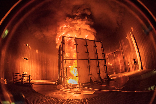 Massive flames billow from a 16-foot-high test enclosure placed within Sandia National Laboratories' Thermal Test Complex. Researchers collect data from experiments at the complex. (Photo by Randy Montoya)