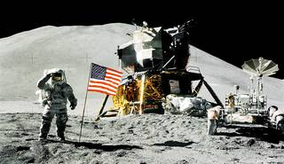 Apollo 15 lunar module pilot Jim Irwin salutes the U.S. flag on Aug. 1, 1971. The lunar module, Falcon, is visible on the right. Irwin and mission commander David Scott were among 12 Americans to walk on the moon between July 1969 and December 1972. Credits: NASA/David Scott