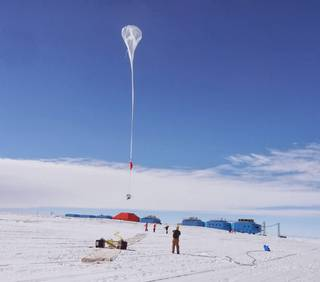 A BARREL balloon launches over Halley Research Station during the Antarctic summer of 2013-2014. The BARREL mission was created to observe precipitating electrons from Earth's radiation belts, supplementing observations by NASA's Van Allen Probes. During a January 2014 solar storm, BARREL measured solar electrons in addition to radiation belt electrons, allowing the team to map how parts of Earth's magnetic field shift and change during a solar storm. Credits: NASA/BARREL