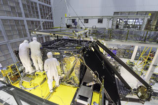 This side shot shows a glimpse inside a massive clean room at NASA's Goddard Space Flight Center in Greenbelt, Maryland where the James Webb Space Telescope team worked meticulously to complete the science instrument package installation. Credits: NASA/Desiree Stover
