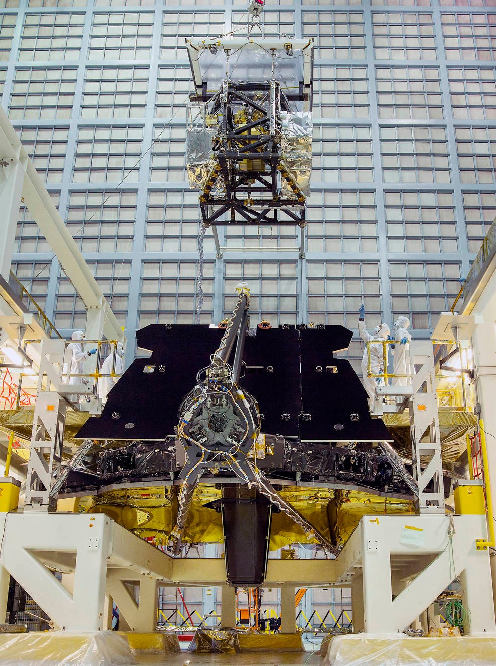 In this rare view, the James Webb Space Telescope team crane lifted the science instrument package for installation into the telescope structure. Credits: NASA/Chris Gunn