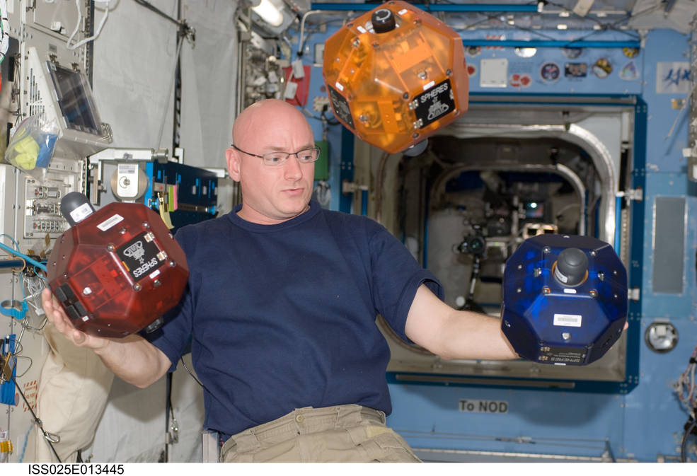 NASA astronaut Scott Kelly works with SPHERES on the International Space Station. Credits: NASA/ISS