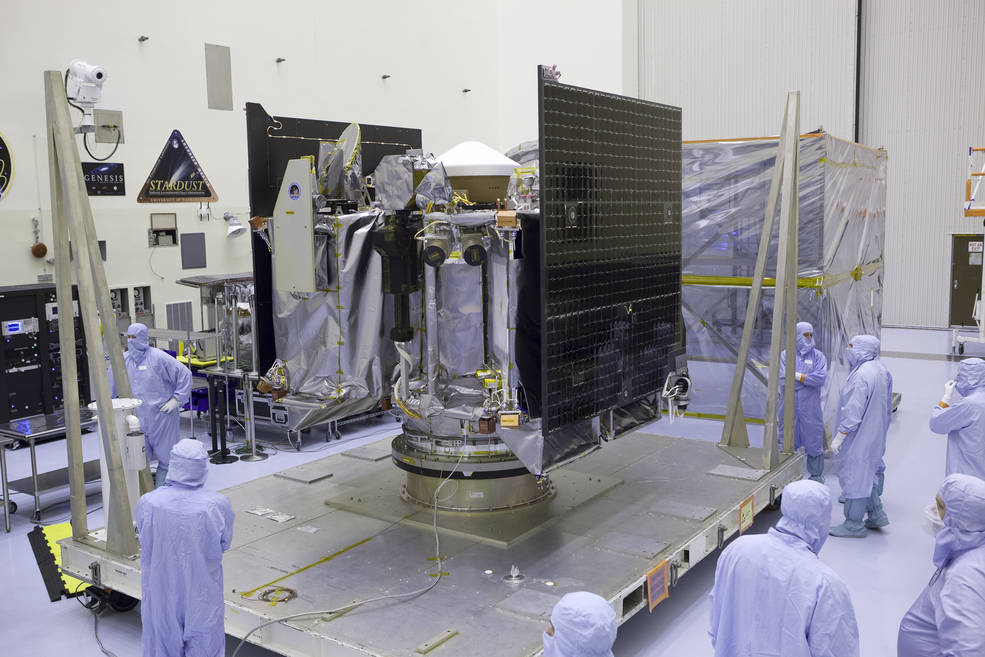 NASA's OSIRIS-REx spacecraft is revealed after its protective cover is removed inside the Payload Hazardous Servicing Facility at Kennedy Space Center in Florida. The spacecraft traveled from Lockheed Martin's facility near Denver, Colorado to Kennedy to begin processing for its upcoming launch, targeted for Sept. 8 aboard a United Launch Alliance Atlas V rocket. Credits: NASA/Dimitri Gerondidakis