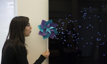 In this example, the speed of the spinning tag on the pinwheel is mapped to onscreen graphics. Image credit: Eric Brockmeyer/Disney Research