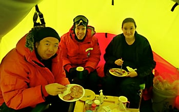 Zhonghua Xu, a research scientist (left); Michael Hartinger, a research professor (center); and Taikara Peek, of Rochester, N.Y. , a graduate student (right), all of the Virginia Tech College of Engineering's Bradley Department of Electrical and Computer Engineering, share a meal in Antarctica. Image credit: Virginia Tech