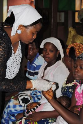 """An expectant mother in Nigeria is tested for HIV while attending a """"baby shower,"""" at a church, where free HIV tests and prenatal care are offered.Photo by Dina Patel/HealthySunrise Foundation"""